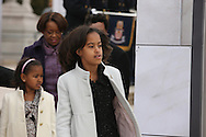 """Malia and Sasha Obama enter  the """"We Are One""""  The Obama Inaugural Celebration at the Lincoln Memorial on January 18, 2009.  Photo by Dennis Brack"""
