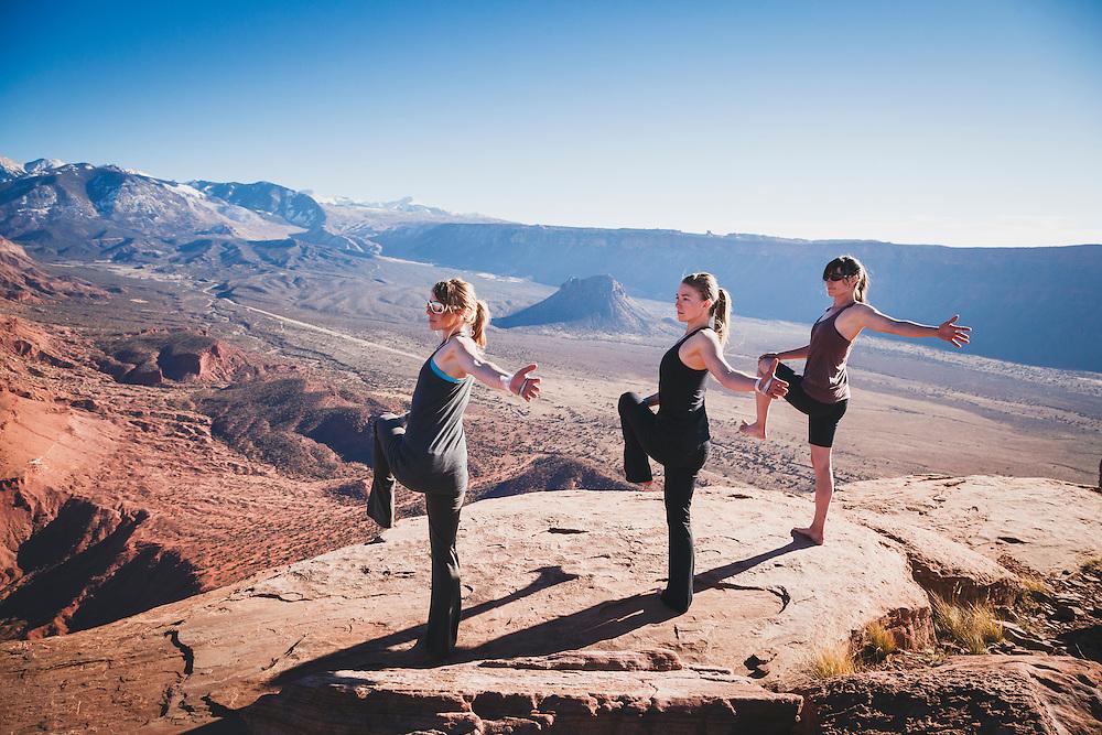 Kim Hall, Jewell Lund and Julia Geisler practice yoga on Castleton Tower.