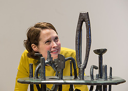 Curator of the exhibition Alice Strang checks over Eduardo  Paolozzi's sculpture at the launch of the Scottish National Gallery of Modern Art major exhibition 'A New Era: Scottish Modern Art 1900-1950'<br /> <br /> © Dave Johnston/ EEm