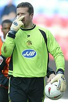 Photo: Chris Brunskill. Wigan Athletic v Ipswich Town. Coca-Cola Championship. 05/03/2005. Wigan's goalkeeper John Filan gestures to the linesman to open his eyes after a bad decision went against his team.