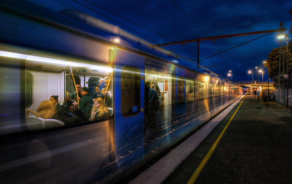 Railway Stations at night. About 6pm as a long exposure catches a train stopped at West Footscray station and then moving away at speed. Pic By Craig Sillitoe CSZ/The Sunday Age/The Age iPad App.15/6/2011 melbourne photographers, commercial photographers, industrial photographers, corporate photographer, architectural photographers, This photograph can be used for non commercial uses with attribution. Credit: Craig Sillitoe Photography / http://www.csillitoe.com<br /> <br /> It is protected under the Creative Commons Attribution-NonCommercial-ShareAlike 4.0 International License. To view a copy of this license, visit http://creativecommons.org/licenses/by-nc-sa/4.0/.