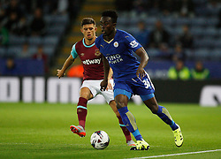 Joe Dodoo of Leicester City and Aaron Cresswell of West Ham United in action  - Mandatory byline: Jack Phillips/JMP - 07966386802 - 22/09/2015 - SPORT - FOOTBALL - Leicester - King Power Stadium - Leicester City v West Ham United - Capital One Cup Round 3