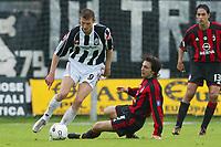Siena 17/4/2004 Campionato Italiano Serie A <br />30a Giornata - Matchday 30 <br />SIENA MILAN <br />TORE ANDRE FLO AND ANDREA PIRLO<br /> Foto Andrea Staccioli Graffiti