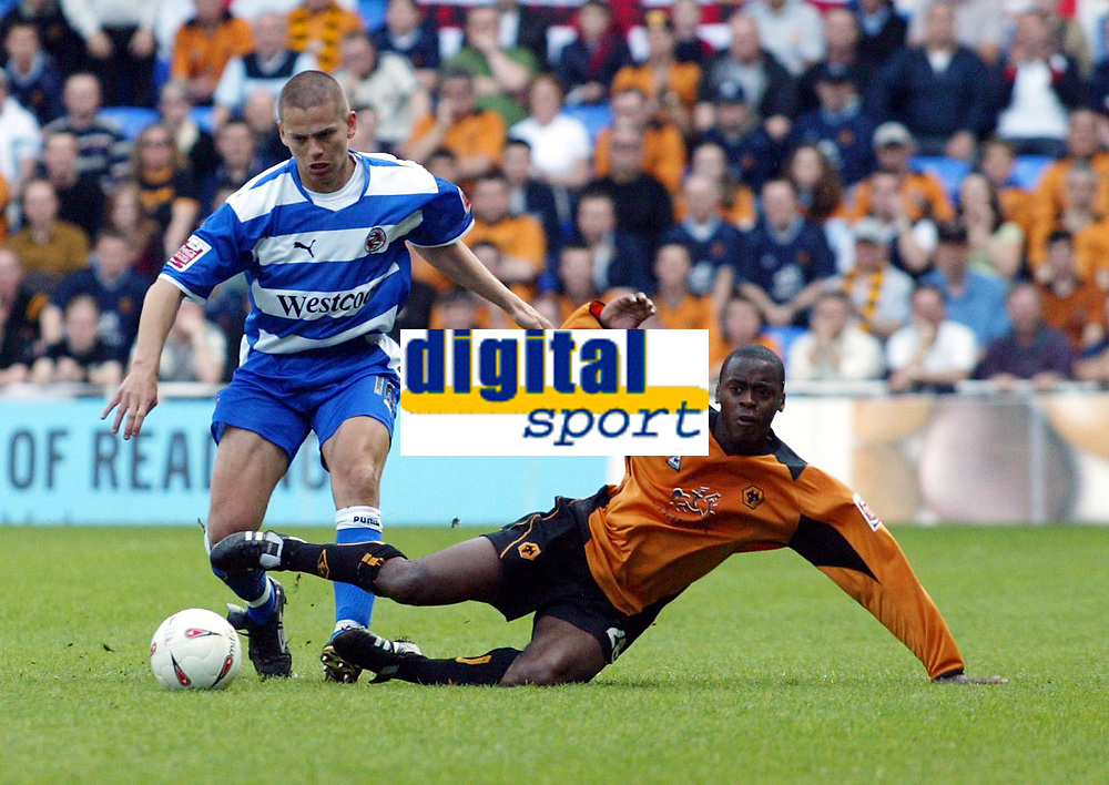 Photo. Chris Ratcliffe<br /> Reading v Wolverhampton Wanderers. Coca Cola Championship. 30/04/2005<br /> Match winner Rohan Ricketts of Wolves goes down under a challenge from  Readings  Ivar Ingimarsson