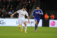 Nelson Oliveira of Swansea city breaks away from Chelsea's Cesc Fabregas. Barclays Premier League match, Swansea city v Chelsea at the Liberty Stadium in Swansea, South Wales on Saturday 17th Jan 2015.<br /> pic by Andrew Orchard, Andrew Orchard sports photography.