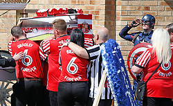 The coffin of Bradley Lowery, the six-year-old football mascot whose cancer battle captured hearts around the world, arrives at St Joseph's Church for his funeral in Blackhall, County Durham.