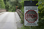A signpost forbidding entry to Slovenian military areas and a bridge near Lake Bled, on 18th June 2018, in Bled, Slovenia.