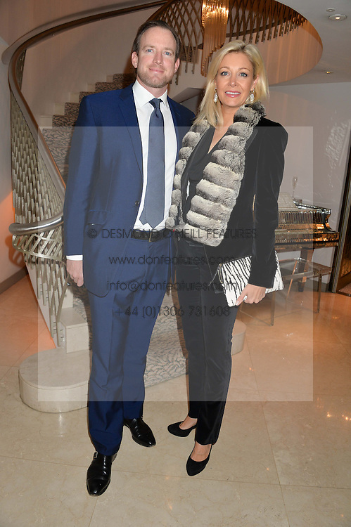 NADJA SWAROVSKI and RUPERT ADAMS at the Fortune Forum Club dinner in the presence of HSH Prince Albert II of Monaco held at The Dorchester, Park Lane, London on 15th January 2014.
