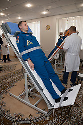 Expedition 57 crew members Nick Hague of NASA, left, and Alexey Ovchinin of Roscosmos, right, conduct tests of their vestibular systems on tilt tables, Wednesday, Oct. 3, 2018 at the Cosmonaut Hotel in Baikonur, Kazakhstan. Hague and Ovchinin are scheduled to launch on Oct. 11 onboard the Soyuz MS-10 spacecraft from the Baikonur Cosmodrome in Kazakhstan for a six-month mission on the International Space Station. Photo Credit: (NASA/Victor Zelentsov)