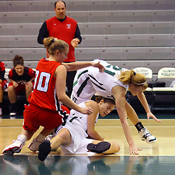 10 January 2009: Carlie Janowiak, Christina Solari, and Nikki Preston all scramble for a loose ball. The Illinois Wesleyan Titans, ranked #1 in the latest USA Today/ESPN poll, take down the Lady Reds of Carthage and remain undefeated,  2-0 in the CCIW and over all to 12-0. This is the first time in the history of the Lady Titans Basketball they have been ranked #1 The Titans and Lady Reds played in the Shirk Center on the Illinois Wesleyan Campus in Bloomington Illinois.