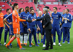 Manchester United manager Jose Mourinho (right) shakes hands with Chelsea's Eden Hazard after the game