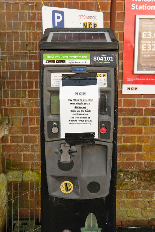 The pay & display pay machine parking meter has a sign stating it has been disabled due to social distancing. It directs users to use the Dash service to pay for the parking.<br /> <br /> Photo by Jonathan J Fussell, COPYRIGHT 2020