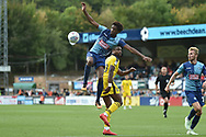 Wycombe Wanderers defender Sido Jambati (2) gets up high to defendduring the EFL Sky Bet League 1 match between Wycombe Wanderers and Oxford United at Adams Park, High Wycombe, England on 15 September 2018.