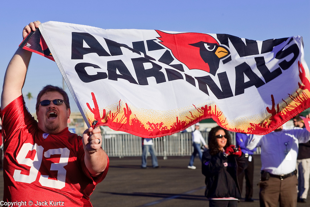Jan. 26, 2009 -- PHOENIX, AZ: Arizona Cardinals fans wave team flags during a pep rally for the team at Sky Harbor Airport in Phoenix after the team left for Tampa to play in the Super Bowl. The Arizona Cardinals are in the Super Bowl for the first time in the team's history. They defeated the Philadelphia Eagles to win the NFC Championship on Jan 18. With a record of 9 - 7 they have one of the worst records of any team to make the Super Bowl. Before this year they had a total of two playoff victories in the team's 111 year history, in 1947 when they won the league championship, and 1998 in a wild card game against the Dallas Cowboys. They face the Pittsburgh Steelers in Tampa on Feb. 1.    Photo By Jack Kurtz / ZUMA Pres