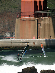 Unidentified board sailors ride the waves as they roll in off the Pacific Ocean, near Fort Point at the southern end of the Golden Gate Bridge, Monday, April 13, 2015, in San Francisco. (Photo by D. Ross Cameron)