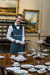 Pictured: Tommy Alexander prepares to serve from a Herend Chinese bouquet pattern dinner service in puce beside a silver epergne by James Deakin and sons, Sheffield 1914.<br /> <br /> Bonhams Scotland's next home and interiors sale is aimed at home makers and interior designers with an emphasis on affordability. Items include a north Italian 17th century later ivory bone inlaid rosewood cabinet on stand valued at GBP5000-6000<br /> <br /> Ger Harley | EEm 31 October 2016