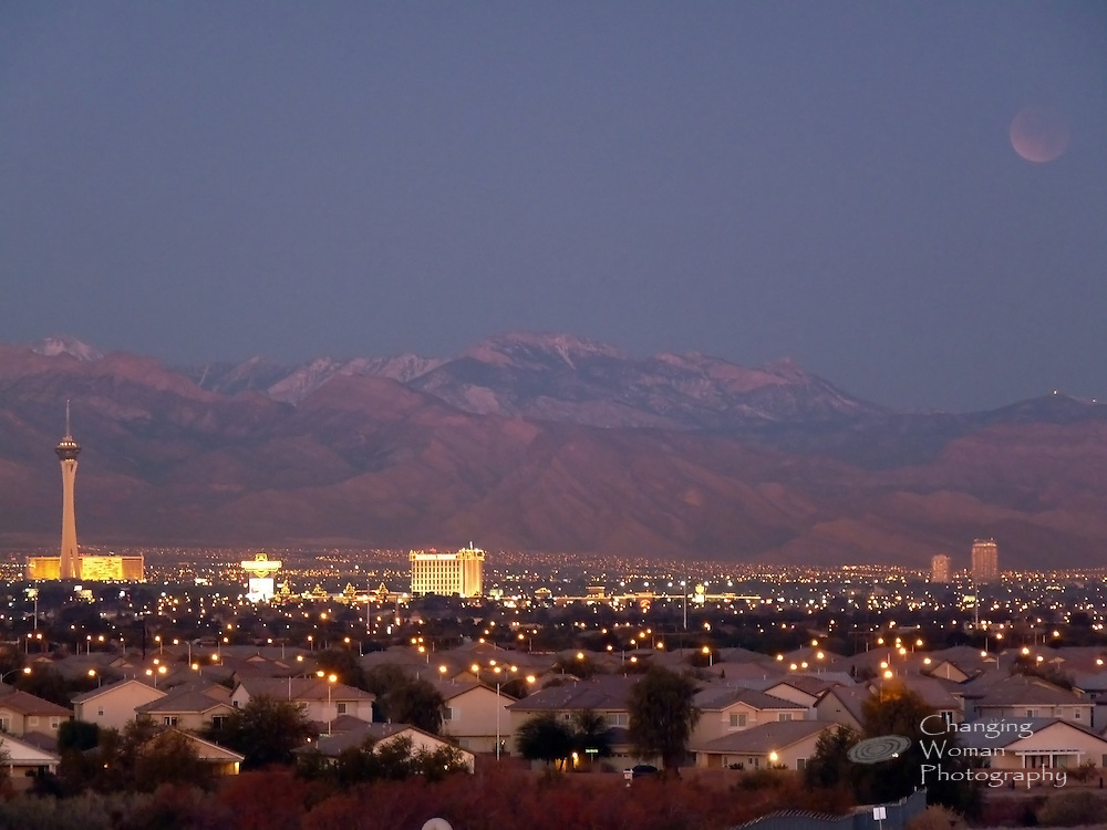 Eclipsed moon sets behind Las Vegas's iconic skyline, early morning hours of Saturday, 10 Dec 2011.
