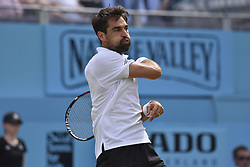 June 23, 2018 - London, England, United Kingdom - Jeremy Chardy of France returns during the semi final singles match on day six of Fever Tree Championships at Queen's Club, London on June 23, 2018. (Credit Image: © Alberto Pezzali/NurPhoto via ZUMA Press)