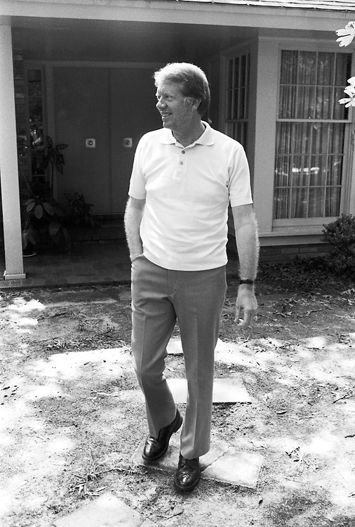 Jimmy Carter in the front yard of his residence at 1 Woodland Drive in Plains, Georgia. The Carters have donated the residence and surrounding land to the federal government as a national historic site upon their passing. - To license this image, click on the shopping cart below -