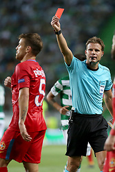 August 15, 2017 - Lisbon, Portugal - Referee Felix Brych from Germany shows the red card to Steaua's midfielder Mihai Pintilii  during the UEFA Champions League play-offs first leg football match between Sporting CP and FC Steaua Bucuresti at the Alvalade stadium in Lisbon, Portugal on August 15, 2017. Photo: Pedro Fiuza (Credit Image: © Pedro Fiuza via ZUMA Wire)