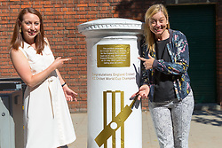 Jenny Smith, Head of Marketing for the ECB and Claire Jackson, Head of Communications at the ECB show their delight as Royal Mail unveils a white-painted postbox outside Lords Cricket Ground with a plaque and graphics that celebrate England's ICC Cricket World Cup Victory. London, July 16 2019.