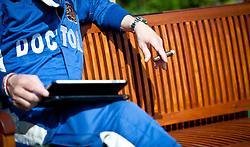 """30.07.2011, Hungaroring, Budapest, HUN, F1, Grosser Preis von Ungarn, Hungaroring, im Bild Feature, ein Mann mit der Aufschrift """"Doctor"""" sitzt auf einer Bank und raucht eine Zigarre // during the Formula One Championships 2011 Hungarian Grand Prix held at the Hungaroring, near Budapest, Hungary, 2011-07-30, EXPA Pictures © 2011, PhotoCredit: EXPA/ J. Feichter"""