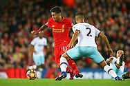 Roberto Firmino of Liverpool looks to go past Winston Reid of West Ham United. Premier League match, Liverpool v West Ham Utd at the Anfield stadium in Liverpool, Merseyside on Sunday 11th December 2016.<br /> pic by Chris Stading, Andrew Orchard sports photography.