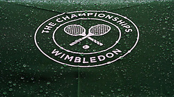 Rain droplets on an official umbrella on day three of the Wimbledon Championships at the All England Lawn Tennis and Croquet Club, Wimbledon.