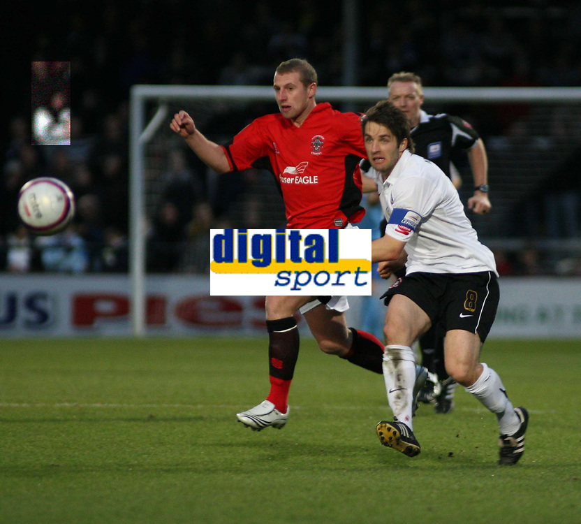 Photo: Mark Stephenson/Sportsbeat Images.<br /> Hereford United v Accrington Stanley. Coca Cola League 2. 24/11/2007.Hereford's Ben Smith passes the ball with Accrington's Ian Craney