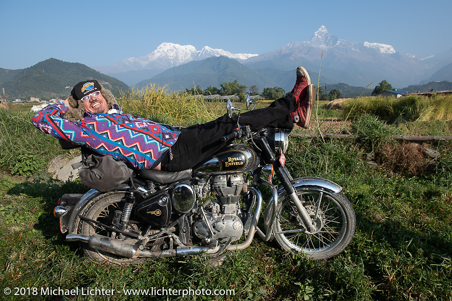 Beanre (Kevin Doebler) poses with a spectacular background of 23,000' peaks on day-4 our our Himalayan Heroes adventure riding from Pokhara to Kalopani, Nepal. Friday, November 9, 2018. Photography ©2018 Michael Lichter.