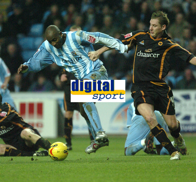 Photo: Ian Hebden.<br /> Coventry City v Wolverhampton Wanderers. Coca Cola Championship. 02/01/2006.<br /> 01 Dele Abedola (Coventry) and Gabor Gyepes (Wolves) contest the ball.