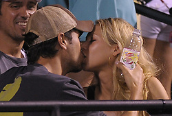Russian born tennis player Anna Kournikova and her lover, Spanish singer Enrique Iglesia attend at the Sony Ericsson tournament in Key Biscayne, FL, USA on April 2, 2009. Photo by Corinne Dubreuil/ABACAPRESS.COM    183215_005 Biscayne Etats-Unis United States