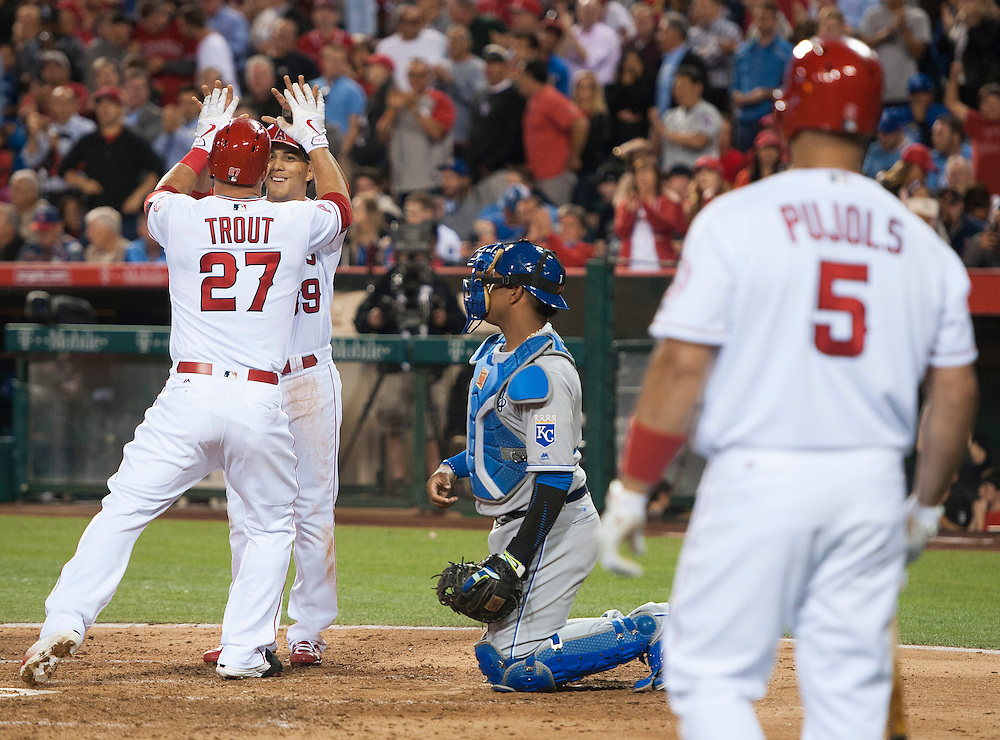 The Angels Mike Trout celebrates at home with Rafael Ortega after his two run home run in the fourth inning against the Kansas City Royals Wednesday night at Angel Stadium.
