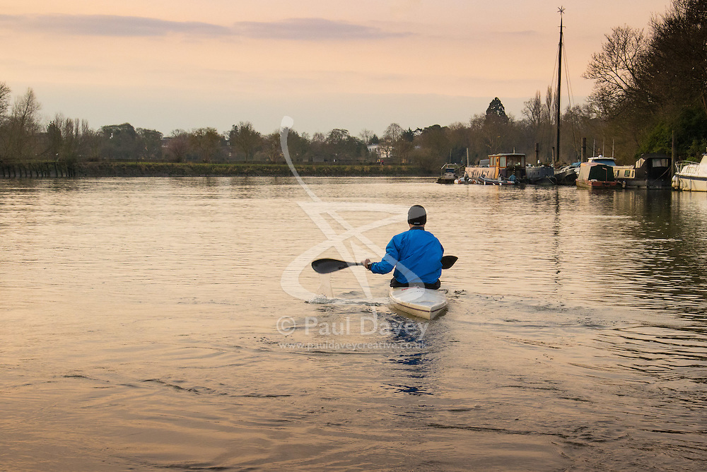 Richmond, London, February 17th 2016. A canoeist paddles into the soft early morning light as dawn breaks over the River Thames. <br /> ///FOR LICENCING CONTACT: paul@pauldaveycreative.co.uk TEL:+44 (0) 7966 016 296 or +44 (0) 20 8969 6875. ©2015 Paul R Davey. All rights reserved.