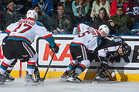 KELOWNA, CANADA - FEBRUARY 10:  Konrad Belcourt #5 of the Kelowna Rockets checks Brendan Semchuk #27 of the Vancouver Giants into the boards on February 10, 2017 at Prospera Place in Kelowna, British Columbia, Canada.  (Photo by Marissa Baecker/Shoot the Breeze)  *** Local Caption ***