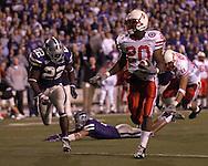 Nebraska running back Marlon Lucky (20) scrambles 40-yards past Kansas State defensive back Justin McKinney (22) for a third quarter touchdown at Bill Snyder Family Stadium in Manhattan, Kansas, October 14, 2006.  The Huskers beat the Wildcats 21-3.<br />