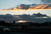 Sunset between cloud formations over London Bridge in London, England, United Kingdom.