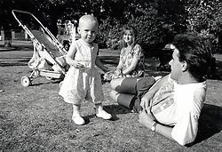 Family in the park, Nottingham UK 1991