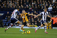 James Chester of Hull city ©  is challenged by West Brom's Scott Sinclair (l) .Barclays Premier league, West Bromwich Albion v Hull city at the Hawthorns in West Bromwich, England on Saturday 21st Dec 2013. pic by Andrew Orchard, Andrew Orchard sports photography.
