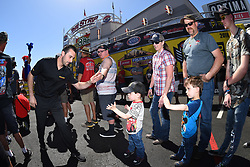 April 8, 2018 - Las Vegas, NV, U.S. - LAS VEGAS, NV - APRIL 08: Vincent Nobile (10 PRO) Chevrolet Camaro NHRA Pro Stock high fives some young fans as he walks off the stage for driver intros during the DENSO Spark Plugs NHRA Four-Wide Nationals on April 08, 2018 at The Strip at Las Vegas Motor Speedway in Las Vegas, NV. (Photo by Chris Williams/Icon Sportswire) (Credit Image: © Chris Williams/Icon SMI via ZUMA Press)