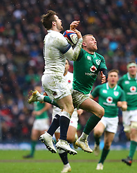 England's Elliot Daly (left) and Ireland's Keith Earls (right) during the NatWest 6 Nations match at Twickenham Stadium, London.