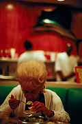 Customer with retro hairdo eating at Wolfie Cohen's Rascal House in Miami, Florida