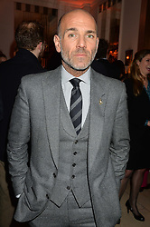 Gieves and Hawkes creative director JASON BASMAJIAN at a reception hosted by The Rake Magazine and Claridge's to celebrate London Collections 2015 held at Claridge's, Brook Street, London on 8th January 2015.
