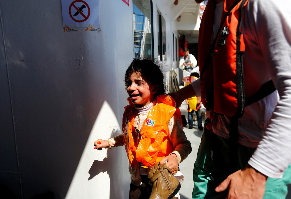 A migrant child cries after being brought onto the Migrant Offshore Aid Station (MOAS) ship MV Phoenix after being rescued from an overloaded wooden boat off the coast of Libya August 6, 2015.  An estimated 600 migrants on the boat were rescued by the international non-governmental organisations Medecins san Frontiere (MSF) and MOAS without loss of life on Thursday afternoon, a day after more than 200 migrants are feared to have drowned in the latest Mediterranean boat tragedy after rescuers saved over 370 people from a capsized boat thought to be carrying 600.<br /> REUTERS/Darrin Zammit Lupi <br /> MALTA OUT. NO COMMERCIAL OR EDITORIAL SALES IN MALTA