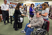 "09 DECEMBER 2010 - PHOENIX, AZ: KATIE RAY (left) and JESSICA MADAGLIA hand out copies of George W. Bush's book, ""Decision Points"" at the Barnes & Noble Bookstore in Phoenix, AZ, Thursday, Dec. 9. More than 2,000 people lined up starting at 5AM to get copies of the former President's book, ""Decision Points."" A handful of protesters demonstrated against President Bush near the bookstore, calling him a ""war criminal.""  PHOTO BY JACK KURTZ"