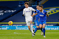 Leeds United forward Patrick Bamford (9) and Brighton and Hove Albion defender Adam Webster (4) in action during the Premier League match between Leeds United and Brighton and Hove Albion at Elland Road, Leeds, England on 16 January 2021.