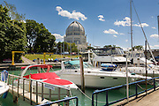 Boats along the Sheridan Shore Yacht Club in Wilmette Harbor with the Bahai House of Worship Wilmette, Illinois, USA.