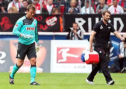 23.07.2011,  Rhein Energie Stadion, Koeln, GER, FSP, 1. FC Koeln vs Arsenal London, im Bild: Michael Rensing (Torwart Koeln) zeigt an, dass es nicht mehr weitergeht. ..// during the friendly match, 1. FC Koeln vs Arsenal London on 2011/07/23, Rhein-Energie Stadion, Köln, Germany. EXPA Pictures © 2011, PhotoCredit: EXPA/ nph/  Mueller *** Local Caption ***       ****** out of GER / CRO  / BEL ******