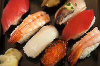 In Japanese cuisine, sushi is vinegared rice topped with other ingredients, especially fish.  Sliced raw fish alone is called sashimi, as distinct from sushi. Combined with hand-formed clumps of rice it is called nigirizushi. Sushi items served rolled inside or around nori is makizushi, toppings stuffed into a small pouch of fried tofu is inarizushi; and toppings served scattered over a bowl of sushi rice called chirashi-zushi.