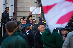 "Mayfair, London, November 28th 2014. A protest against Egypt's leader Al-Sisi descended into moinor scuffles as right wing ""patriots"" from anti-Islamic group Britain First arrived to protest against the presence of Islamist preacher Anjem Choudary, who was recently arrestred as part of an ant-terror operation. Playing patriotic British Music, Britain First accused Muslims of worshiping a ""devil"" and a ""paedophile prophet"". Police had to intervene before hotheads on both sides became violent. PICTURED: Young Muslims taunt Britain First Acrivists."